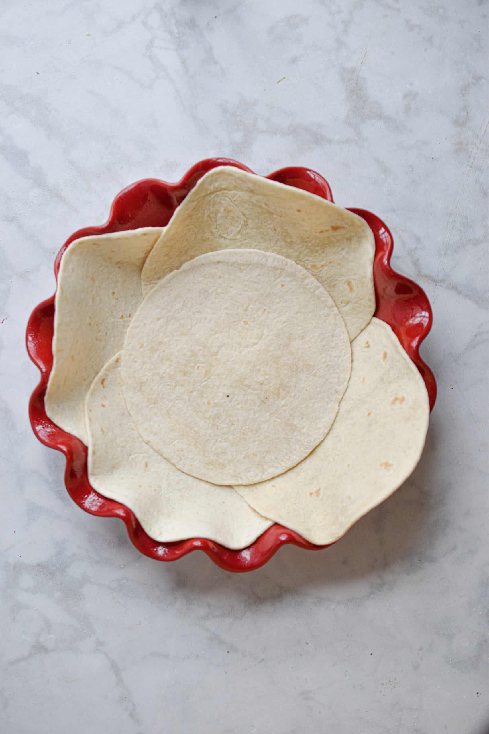 line the pie pan with flour tortillas