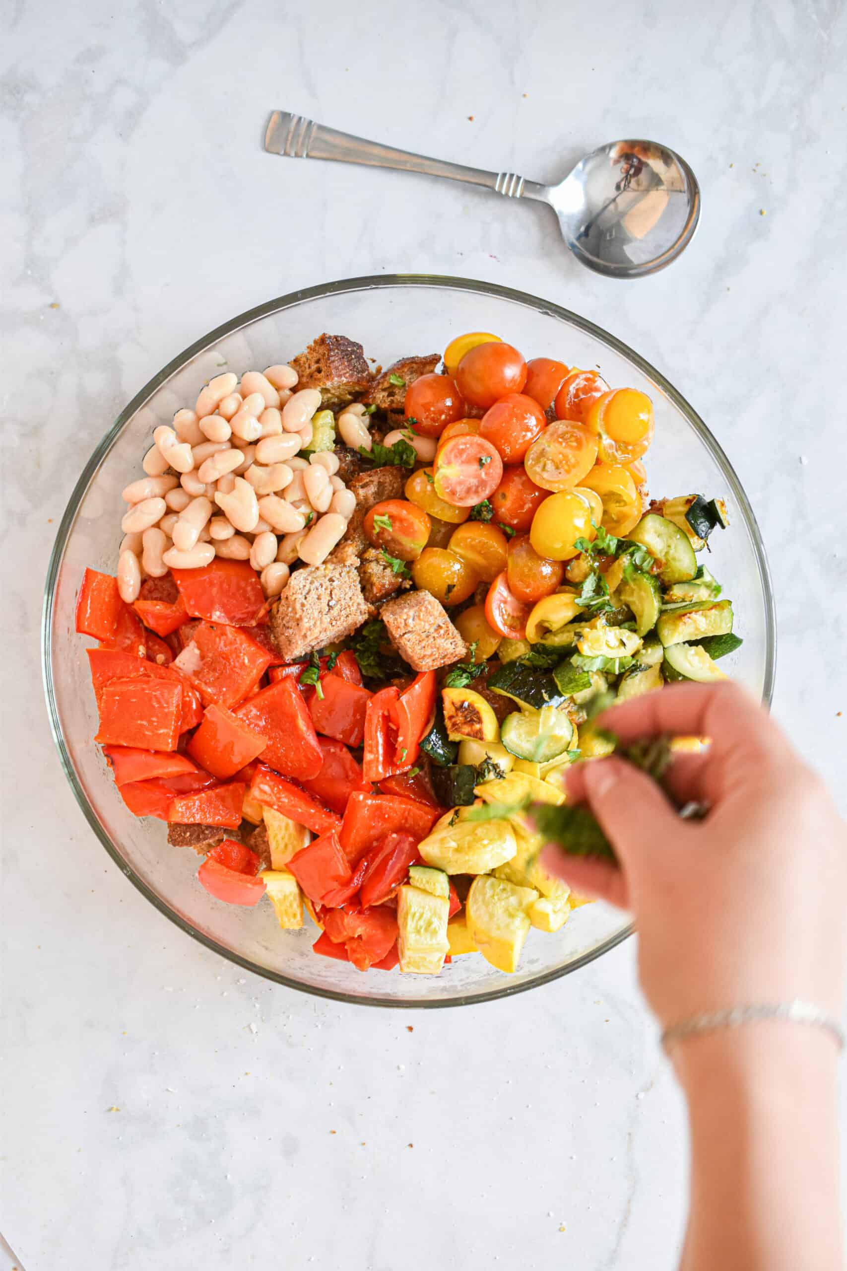 Add basil to the roasted vegetable panzanella