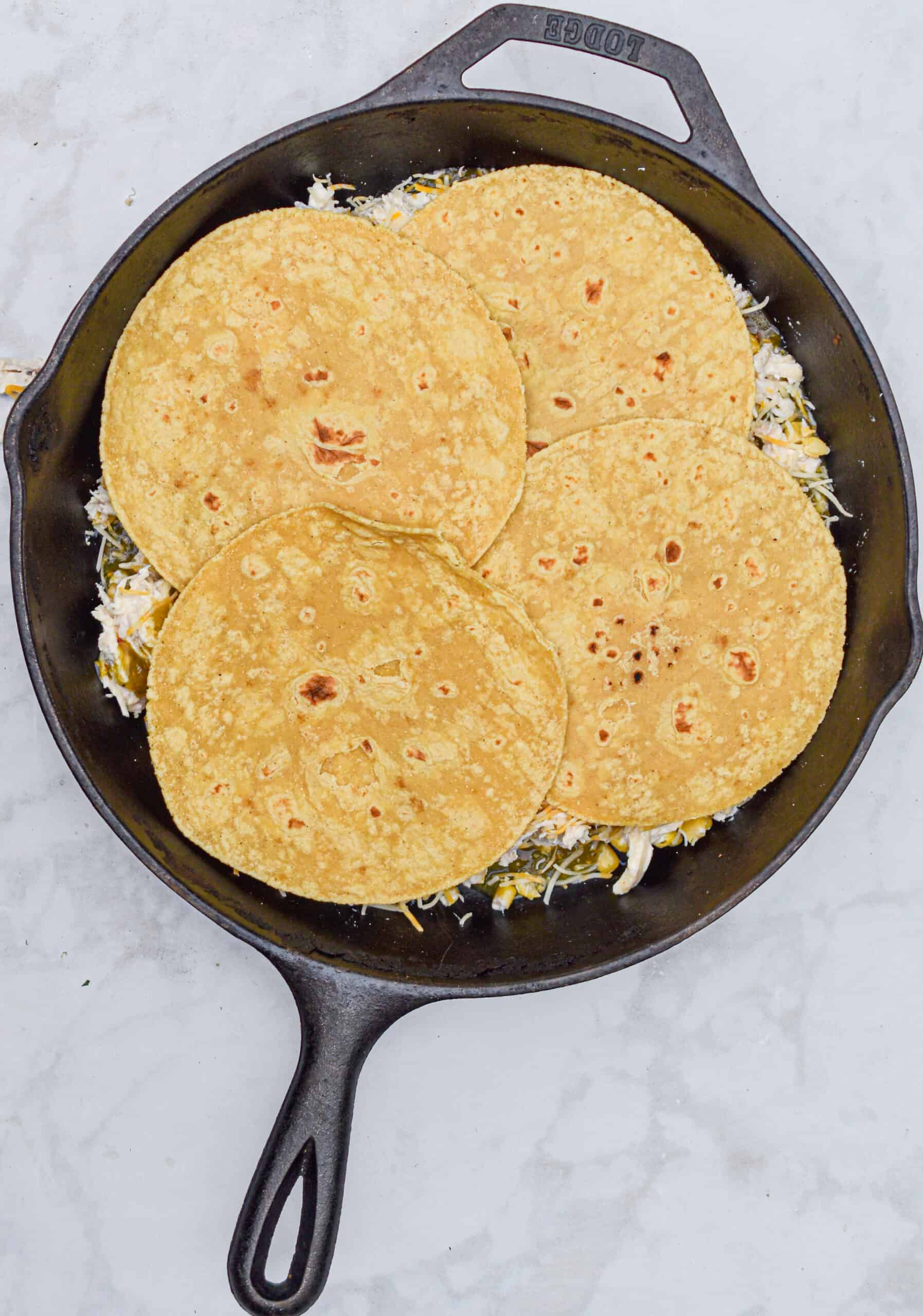 Add another layer of corn tortillas