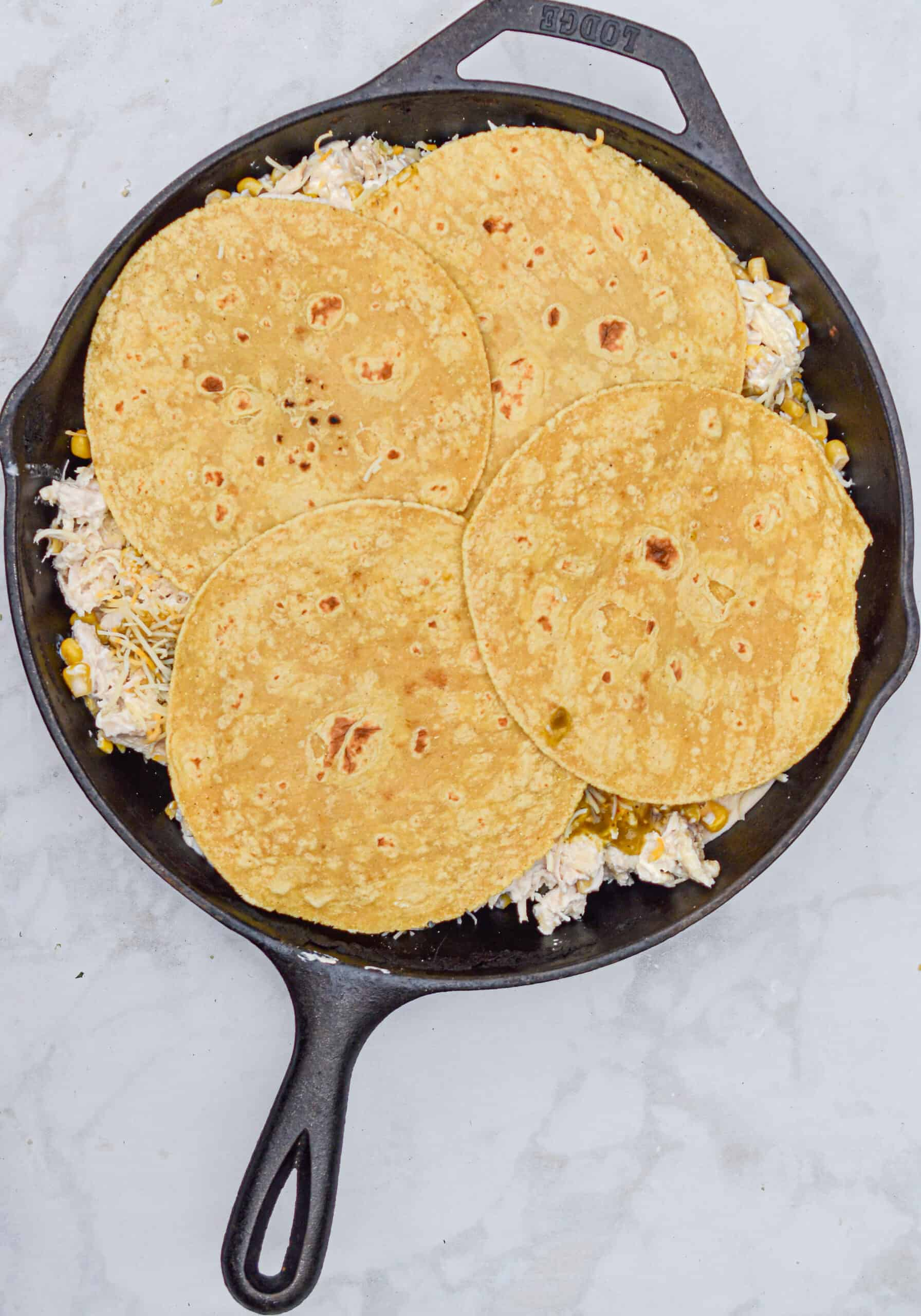 Top with the final layer of corn tortillas