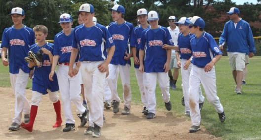 Pacific Little League players head to the championship ceremony after beating Federal Way.