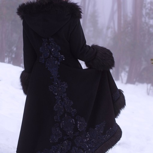 Black coat with fur trim and beaded navy lace