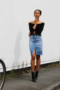 Denim skirt, fish nets and boots