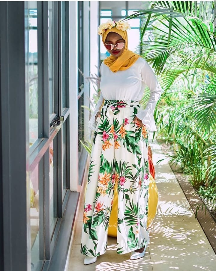 Modest Fashion With Moderne | Dressing Queens - Lysa Magazine hijab store modest fashion store in kenya made in kenya mode.rne by ameena abdul and muna. Moest fashion by brand moderne girl wearing a yellow hijab sunglasses, white top and tropical palazzo wide leg pants