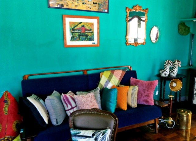 seat with different colored cushions Interior Design With A Twist | Douglas & Kline Interiors - Lysa Magazine The Right Mix Of Modern and Vintage Interior accessories