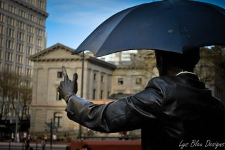 portland photos - portland pictures - portland images - statue - pioneer courthouse square - man with umbrella