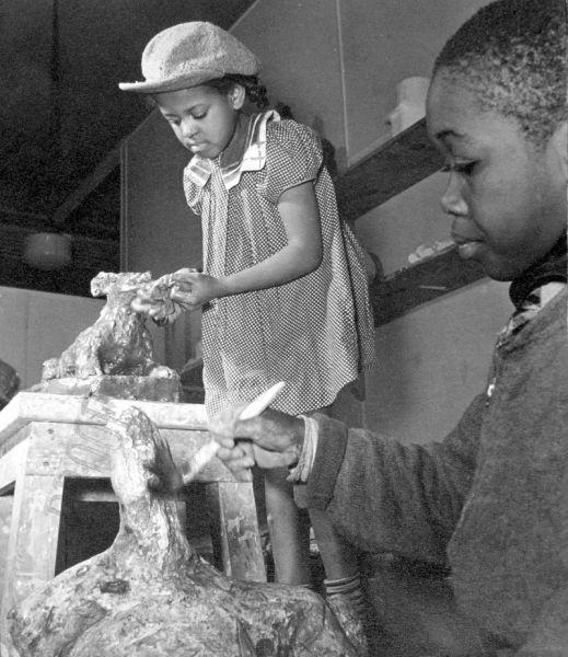 two_children_at_the_harlem_community_art_center_in_1939