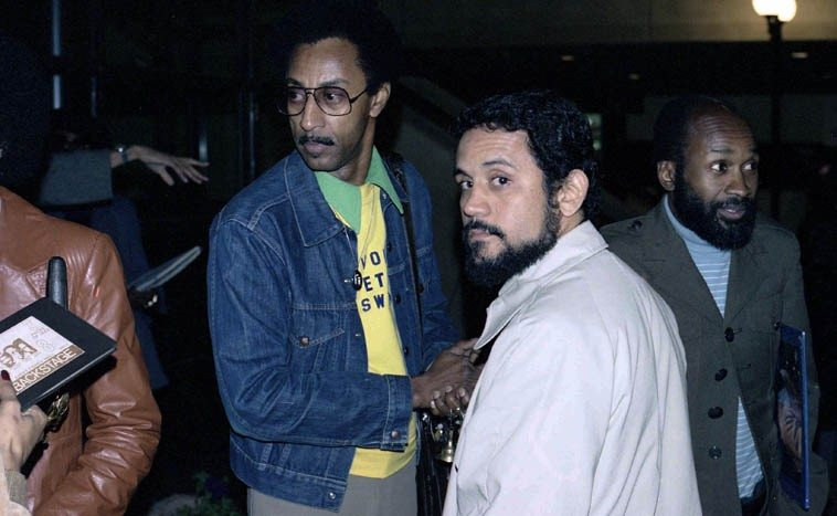 Roberto Miranda with band members of Vous et Swing: Richard Davis, the trumpeter, far right,  and the leader Ron Jefferson with glasses (the guy in brown leather jacket holding an alto is Gary Bartz) --  photo by Mark Weber -- Los Angeles -- April 22, 1978 ---- Roberto has played bass for Bobby Bradford  since Lincoln's Gettysburg Address (which we'll listen to today in a hipster rendition by Lord Buckley), the first time I ever heard Roberto he was subbing for Mark Dresser in Stanley Crouch's Black Music Infinity in May of 1975