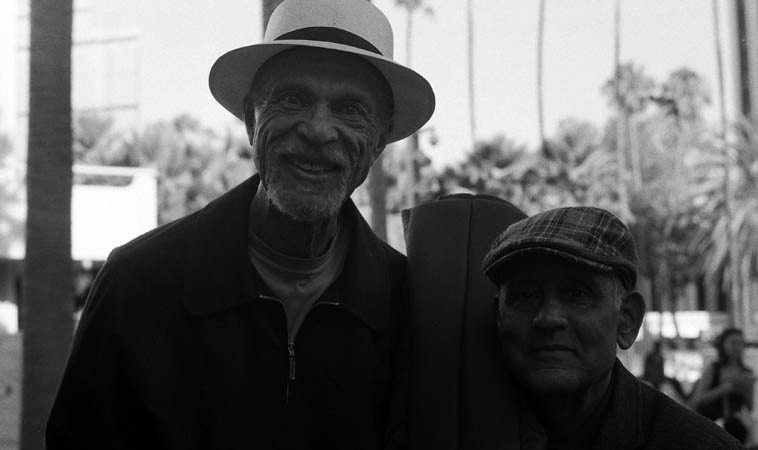 Two Angeleno bass players: Tom Williamson and Roberto Miranda ---- August 9, 2o13 ---- Roberto  had just performed with the Bobby Bradford Mo'tet at L.A. Country Museum of Art, Tom had drove out from Phillips Ranch/Pomona -- photo by Mark Weber