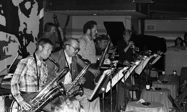 Lester took his time, and fate waited -------- Prez Conference -- Donte's, North Hollywood -- May 27, 1979: Bob Efford, baritone; Bob Cooper, Dave Pell, Bob Hardaway, tenor saxophones; Bill Berry, cornet; Bill Holman's charts; Monty Budwig, bass; Nat Pierce, piano; Frankie Capp, drums ---- the front tables are empty simply because nobody wanted a face full of saxophone, the place was packed for Lester Young music: Lester didn't make his first recordings until he was 27. When I'm showing visiting musicians around Albuquerque, I like to take them by a few spots, like architect Bart Prince's spaceship of a house (3501 Monte Vista NE) and where Harry Partch lived during his high school years (1913-1919 -- 208 S. High Street) and to where Lester's father had his shop (1929-1930 possibly as early as late 1928) Young's Music Store (115 1/2 W. Gold, downtown) and tell them how Ben Webster rescued Lester from drowning in the Rio Grande one summer when they were teenagers -- (Lester Young's father Billy had picked up Ben in Amarillo during one of the family band's swings through Texas, so, he was living with them and being taught how to read music by Billy) -- En route to the radio show I park not a block away from where Lester's young wife Beatrice worked as a domestic for a physician and always regard the sidewalk that Lester must have walked upon as I walk along . . . . .