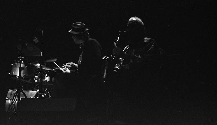 "Lee Konitz Quartet in Albuquerque ---- March 12, 2o15 ---- George Schuller, drums; Dan  Tepfer, piano; Jeremy Stratton, bass -- photo by Mark Weber ---- Before Lee arrived the rumor  was that he has been singing on his performances, and I'm happy to report his ""syllabification,"" (Lee's word)  which strikes me as the most  correct term for his way with vocalization (rather than scat) was wonderful, it struck me (if I may  be permitted to stray into the realm of psychoanalysis) as a person in their later years returning to  something of his youth: Lee's being his early studies with Lennie ---- (""We are all of us palimpsests, we  carry the past around, it comes surging up . . ."" -- Penelope Lively) ---- And his tone on the alto  was deeply heart-felt, a beautiful human sound ---- James Newton, who was in attendance (he and  George have a Dolphy connection) said to me about Lee's sound: ""Every note has so much history in it, wow"""