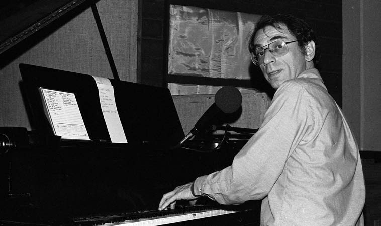 """Dave Frishberg at KPFK live broadcast from Studio A on John Breckow's  all-night jazz radio show -- May 27, 1979 -- photo by Mark Weber -- Dave lived in Los  Angeles (presumably in the Valley?) 1971-1986 (currently resides up the coast in Portland)  ---- this night after an evening of Prez Conference at Donte's we popped in at KPFK (drive down  Lankershim hang a left into Cahuenga Pass) and there's Dave Frishberg telling great stories  about his days with Al & Zoot ---- He had his home-grown rolled in peculiar papers that were  5-inches long (remember Zig-Zags were something like 3) he called this crop """"Van Nuys Silver"""""""