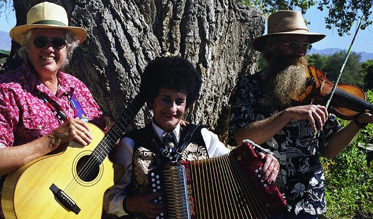 Ken & Jeanie w/ Antonia Apodaca who hails from the pre-war days of dance hall  bands of the Northern New Mexico mountain villages of the Sangre de Cristos, and  she plays a jumping guitar, too ---- Harvest Festival at the Maze Corn Field -- October 9, 1999 -- photo by Mark Weber