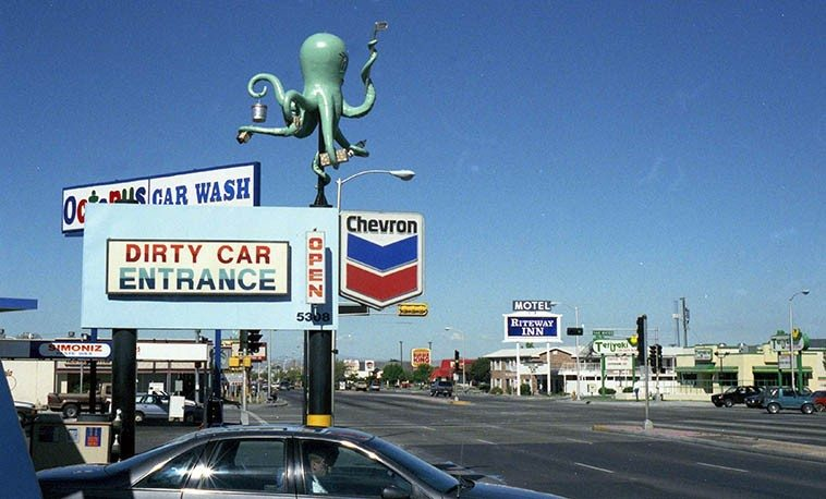 "Octopus Car Wash -- September 11, 1995 -- Central Avenue (old Rt.66) and San Mateo, Albuquerque, (it's no longer there, or anywhere) -- photo by Mark Weber ----- when Horace Tapscott was in town for a couple concerts we were driving past that car wash and Horace said, in his elliptical way: ""I see. Car wash. Octopus really gets it done."""