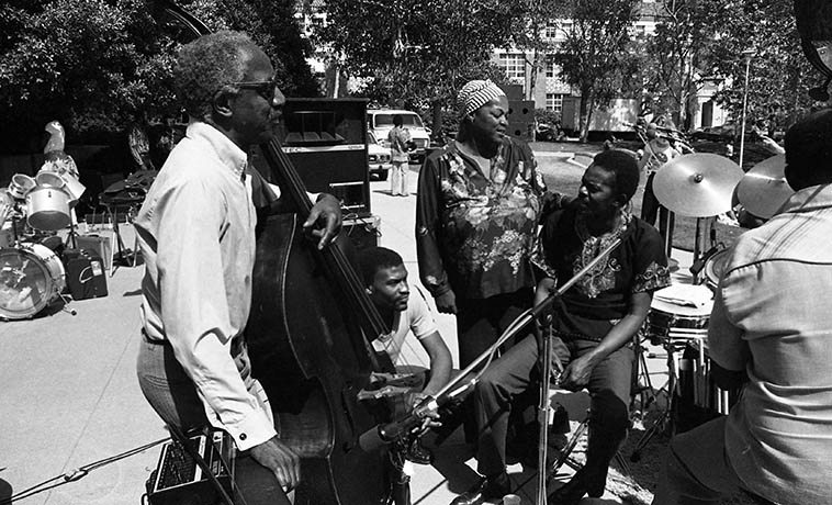 Pan Afrikan People's Arkestra before their set at UCLA May 16, 1981 -- Left to right: bassist David Bryant, drummer Fritz Wise, pianist Linda Hill, conductor/pianist Horace Tapscott, bassist Nyimbo Henry Franklin (they had 4 bassists that afternoon) -- photo by Mark Weber
