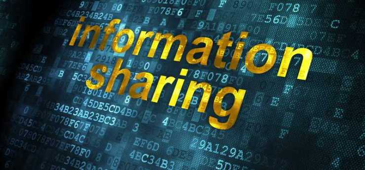 The phrase information sharing written atop digital binary code