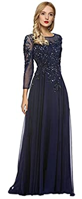 Rival the beauty of a starry night in this elegant evening gown. The sheer, tonal overlay has long, slender sleeves and a bateau neckline. Crystalline appliques add glamorous glints along the bodice and skirt while a strapless lining lends tonal cove...