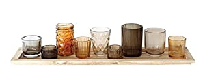 "Wood & glass construction Glasses can be rearranged on tray Colors ranging from brown to orange Tray: 22""L x 5. 5""W x 0. 5""H 9 votive holders total, 7 different sizes, ranging from 2""L x 1""H to 2. 5""L x 4""H Tea light candles not included"