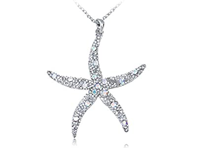 OCEANIC DESIGN - This silver toned alloy necklace features a dangling rhinestone encrusted starfish! Pendant is in the shape of the peaceful star shaped sea creature and adorned with all over sparkly crystal clear rhinestones and a smattering of auro...