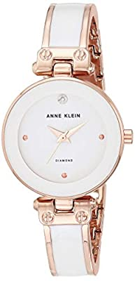 Rose gold-tone watch featuring glossy minimalist dial with dauphine hands and diamond at 12 o'clock 34 mm rose gold-tone metal case with mineral dial window Japanese quartz movement with analog display Enamel-filled alloy bangle with jewelry-clasp cl...