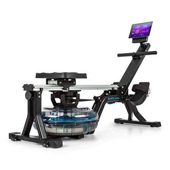 Capital Sports Flow M1 - Rameur à Eau, Résistance Naturelle, 8 Niveaux, 13 litres Max, Ecran LCD, Support de Tablette intégré, roulettes, Repose-Pieds avec Sangle réglable, Noir