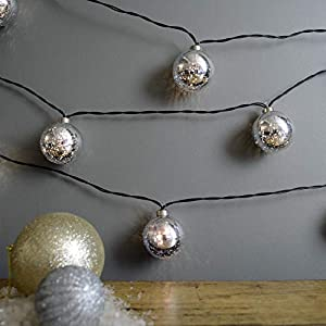 Designed by Martha Stewart, this silver faux mercury glass ball light strand measures 90-inches long Durable shatter-resistant plastic bulbs give the look of mercury glass without the risk of broken glass-perfect for families and pet owners! Battery ...