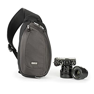 """Fits small–medium mirrorless system (1 body, 2–3 lenses), up to an 8"""" tablet Example: Olympus EM-5 attached to 17mm f/1.8, 12mm f/2.0, 75mm f/1.8 and iPad Mini Easy rotation for rapid access to gear and accessories Stabilizer strap holds the bag stea..."""