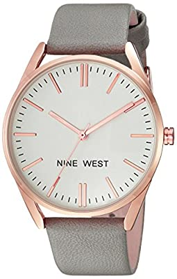 Domed mineral crystal lens; Matte white dial with rose gold-tone hands and markers; Black printed outer minute track Grey strap with buckle closure Japanese quartz movement with analog display Case diameter: 36 millimeter Not water-resistant