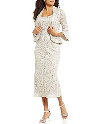 RUNS LARGE. ORDER ONE SIZE DOWN Two piece jacket dress with removable lace jacket neck, Sheath Dress Jacket: collarless, open front, three-quarter sleeves, allover sequined lace with ruffled hem; hits at hip Sleeveless dress with slit at the back, Po...
