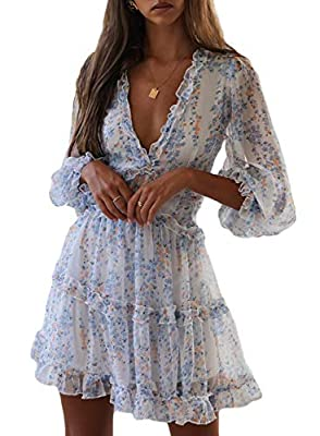 The ruffled dress is chic and graceful.Ruffles, ruffles, ruffles! Showcasing a floral print on a mauve base lightweight fabrication. Designed with a ruffle tiered draped neckline and long balloon sleeves. The balloon sleeves and ruffle tiered hemline...