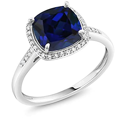 MEASUREMENTS: 8x8mm Cushion Blue Created Sapphire, 1x1mm Round Single Cut I - J Diamond. Total Carat Weight is 2.5 cttw. CRAFTED: in 10k White Gold with 10k stamp. USA BASED COMPANY AND SERVICE: Our jewelry passes extensive quality checkpoints before...