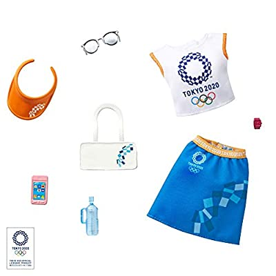 This Barbie doll fashion pack incorporates recognizable icons of the Olympic Games Tokyo 2020 into graphics and prints (doll not included; sold separately, subject to availability) A white top with colorful logo is paired with a blue skirt, both bran...