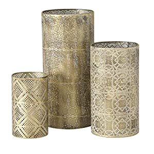 Inspired by luxurious lattice work in far away places, display one or all of these Intricate Hurricane Lanterns to illuminate romantic patio dinners or relaxing soaks in the tub. Cylindrical openwork metal finished in gold gently filters light while ...