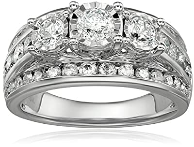 10K 3-SET MIRACLE WEDDING RING SET: A well-crafted and elegant Bridal set in 10k white gold featuring 3-stone miracle diamond wedding ring set. A miracle plate setting that adds on to the look of magnificence to the center stone. This is combined wit...