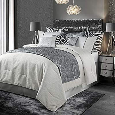 The gorgeous Celeste Comforter Set will add a modern elegant feel to your bedroom This comforter set features a contemporary texture complemented by a soft luxurious velvet trim and embellished with shimmering silver accents 4 piece comforter set inc...