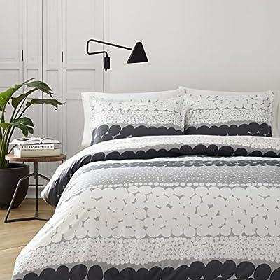 Comforter + 2 shams Percale Cotton, reversible, includes matching shams, machine washable. Features signature Marimekko designs. D Comforter is reversible