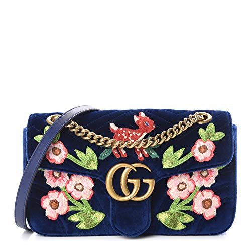 """51Wt4bKuPDL Height: 176cm Bust: 85cm Waist: 60cm Hips: 89cm Navy blue 'GG Marmont' quilted velvet shoulder bag from Gucci. Size small. Fastened with snap. Enriched by a colourful fauna & flora embroidery. Metal logo at front. Embroidered motif of heart at back. Adjustable chain and leather shoulder strap. Pink satin, lined interior has 1 compartment and 1 zip pocket. Antiqued gold-tone metal hardware. Satin lining LIMITED NUMBERS MADE WORLDWIDE Deer Shade Blue Cobalt Fawn Velvet Marmont GG Leather Bag Italy Authentic Gold Chain handbag New New A MUST HAVE. style 443497 9QINT 4567 DEEP blue small shoulder bag embleished w flowers and a red fawn deer. Nature. only 1. Made in Italy Antique gold-toned hardware Double G 10""""W x 6""""H x 3""""D 12"""" handle drop 21"""" strap drop Height: 15cm Width: 26cm Adjustable chain and leather shoulder strap. Pink satin, lined interior has 1 compartment and 1 zip pocket. Antiqued gold-tone metal hardware. Satin lining LIMITED NUMBERS MADE WORLDWIDE"""