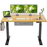FEZIBO Electric Height Adjustable Standing Desk with Drawer, 55 x 24 Inches Splice Board, Black Frame/Bamboo Top