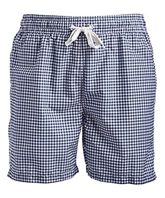 Plaid swim trunk with elasticized waist featuring tie closure and mesh lining UPF 50+ protection Pockets: two side, one back flap