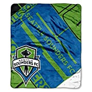 """Features MLS team name in block letters in background with team logo in front Soft and warm raschel fabric; oversized; decorative binding around all edges Measures 50""""W x 60""""L Machine wash cold separately using delicate cycle and mild detergent. Do n..."""