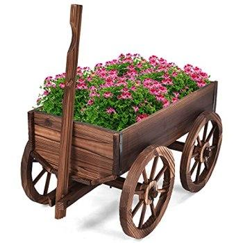 GOPLUS Brouette à Fleurs en Sapin Carbonisé avec Poignée Réglable et 4 Roues,Chariot à Fleurs avec Trou de Drainage, Idéal pour Patio, Jardin, Terrasse, 120 x 43 x 53,5 CM, Marron