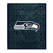 Officially Licensed Team Colors and Graphics 100% Polyester Measures approximately 60''x70'' (LxW) Plush front with reversible plush brushed back Machine washable