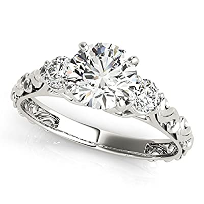 Three-Stone Diamond Engagement Ring: This 1/2 carat halo round engagement ring crafted in solid 14k white gold, expresses the harmony of union with delicate in diamond design. The ring features a center big white stone and two small small diamond sto...