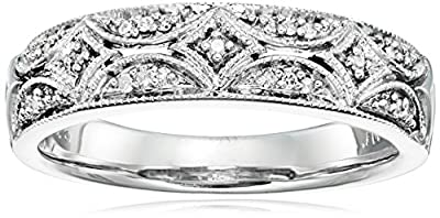 Sterling silver band with milgrain edging and prong-set diamond accents Crafted in .925 sterling silver All our diamond suppliers confirm that they comply with the Kimberley Process to ensure that their diamonds are conflict free Imported