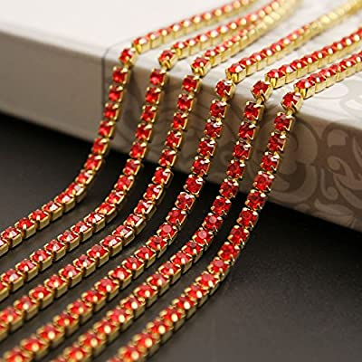 Brass base gold color chain with crystal red rhinestones Comes in many colors, including classic crystal and crystal AB color, and 9 sizes SS6-SS16, easy to match colors Package includes 10 yards crystal rhinestone claw chain, about 280 stones per ya...