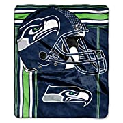 "Features NFL team name and logo Soft and warm raschel fabric; oversized; decorative binding around all edges Measures 50""W x 60""L Machine wash cold separately using delicate cycle and mild detergent. Do not bleach. Machine dry separately on gentle cy..."