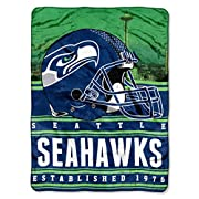 "Features NFL team name and logo Super soft, silk touch fabric Measures 60""W x 80""L Machine wash cold separately using delicate cycle and mild detergent. Do not bleach. Machine dry separately on gentle cycle. Remove promptly. Do not iron. Made of 100%..."