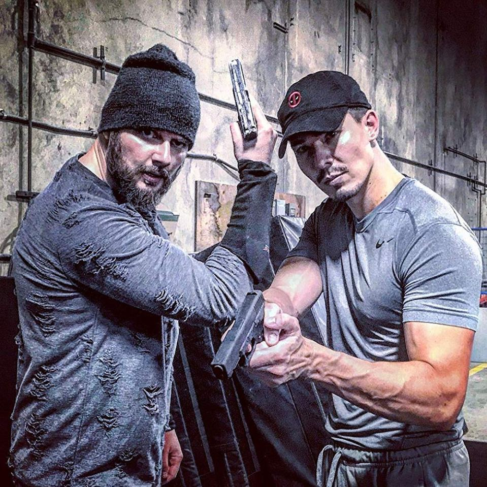 Behind the scenes photo in Wu Assassins where the Russian bad guy and Lewis Tan pose together.