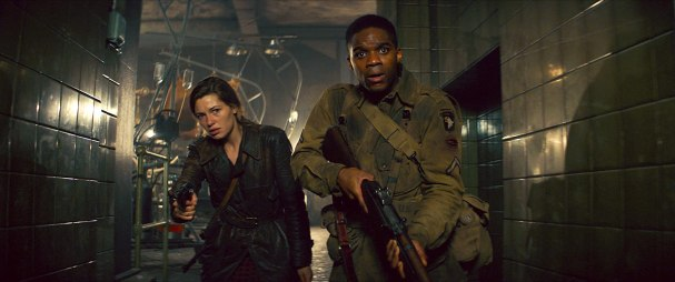 Jovan Adepo and Mathilde Ollivier in Overlord (2018)