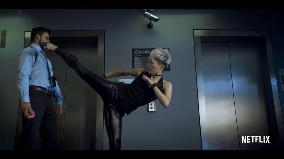 Zan (Juju Chan) from Wu Assassins, kicking a police officer's butt.